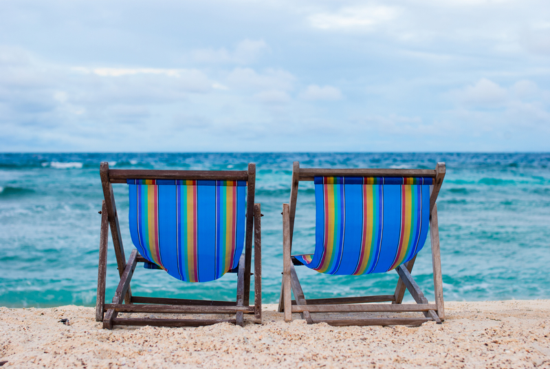 http://www.dreamstime.com/royalty-free-stock-photo-beach-chairs-blue-sea-sky-image34511425